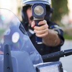 motorcycle-police-officer-with-radar-gun